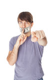 Young man with his mouth sealed by a hundred dollar bills  Royalty Free Stock Photos
