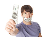 Young man with his mouth sealed by hundred dollar bills for bribe Stock Photo