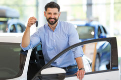 Young man with his new car Royalty Free Stock Photo