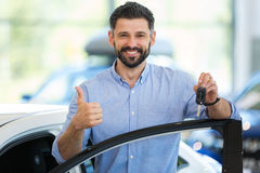 Young man with his new car Royalty Free Stock Photos