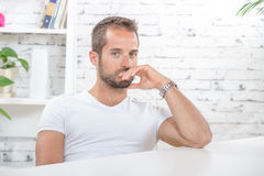 Young man in his office Royalty Free Stock Photo