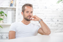 Young man in his office Royalty Free Stock Image