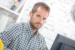 Young man in his office Stock Photos