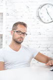 Young man in his office Stock Photo