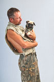 Young man and his pedigreed Pug Royalty Free Stock Photos