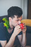 Young man with his pet parrot drinking coffee Royalty Free Stock Photo