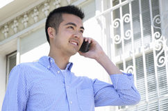 Young man on his phone outdoors Royalty Free Stock Image