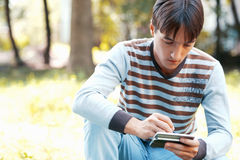 Young man with his pocket computer Royalty Free Stock Photo