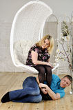 Young man and his pregnant wife play the fool Royalty Free Stock Photo