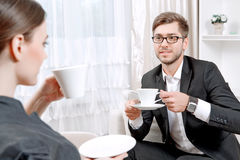Young man with his psychologist Stock Photography