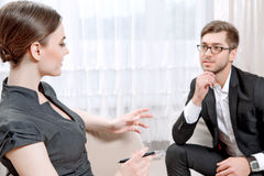 Young man with his psychologist Stock Photo