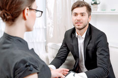 Young man with his psychologist Stock Photos