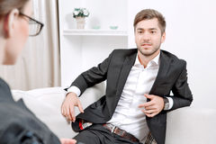 Young man with his psychologist Stock Images