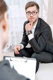 Young man with his psychologist Royalty Free Stock Photos