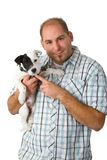 Young man and his puppy Royalty Free Stock Photos