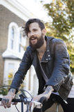 Young man in his 20s or early 30s with bicycle Royalty Free Stock Photo