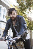 Young man in his 20s or early 30s with bicycle Royalty Free Stock Images