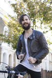 Young man in his 20s or early 30s with bicycle Stock Photos