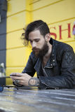 Young man in his 20s or early 30s in cafe Royalty Free Stock Photography