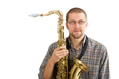 Young man with his saxophone Stock Photos