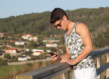 Young man and his smartphone Stock Photography