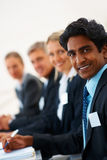 Young man with his staff at a business seminar Stock Photo
