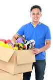 Young man with his stuff inside the box Stock Photo