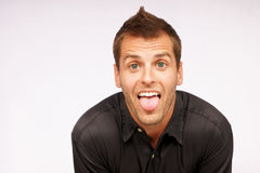 Young man and his tongue Royalty Free Stock Photo