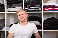 Young man with his wardrobe Stock Images