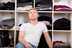 Young man with his wardrobe Stock Photos