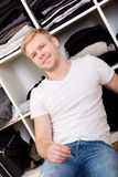Young man with his wardrobe Stock Photography