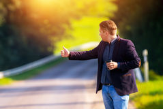 Young man hitch-hiking Royalty Free Stock Images