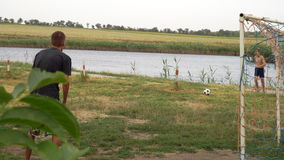 A young man hits a ball head. The game with the ball outside the city stock video