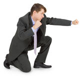 Young man hits fist from seated position Stock Images