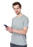Young man hold with cellphone Royalty Free Stock Images