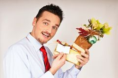 Young man hold Christmas gift Royalty Free Stock Photos
