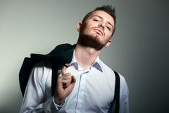 Young man hold coat Royalty Free Stock Photo