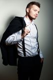 Young man hold coat Royalty Free Stock Photography