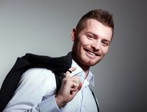 Young man hold coat Royalty Free Stock Image