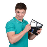 Young man hold credit card from purse. Royalty Free Stock Image