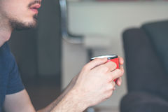 Young man hold cup of morning coffee Stock Images