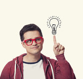 Young men hold finger on abstract idea lamp. Stock Images