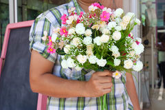 Young man hold with flowers Royalty Free Stock Photography