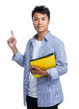 Young man hold with folder and finger point up Stock Photos