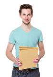 Young man hold with folder Royalty Free Stock Photography