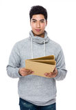 Young man hold with folder Royalty Free Stock Photos