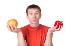 Young man hold in his hand fresh pepper and grapef Royalty Free Stock Photos