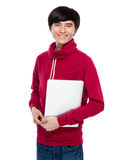 Young man hold with laptop computer Stock Image