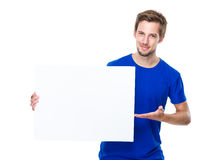 Young man hold present with white banner Royalty Free Stock Photography