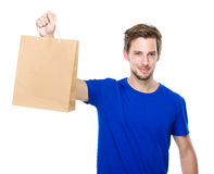 Young man hold with shopping bag Stock Photography